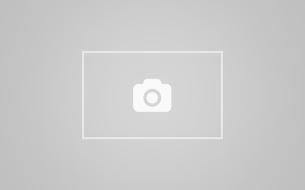 Nicki Blue tied up to a wall